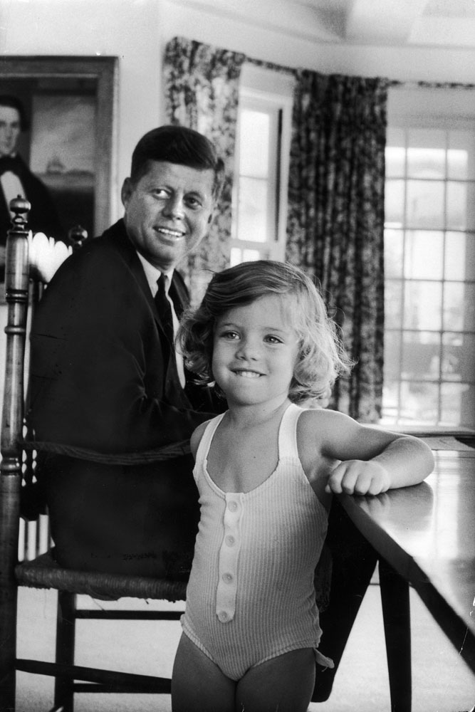Sen. John Kennedy with his young daughter Caroline at home after he was named the Democratic Party presidential candidate in 1960.