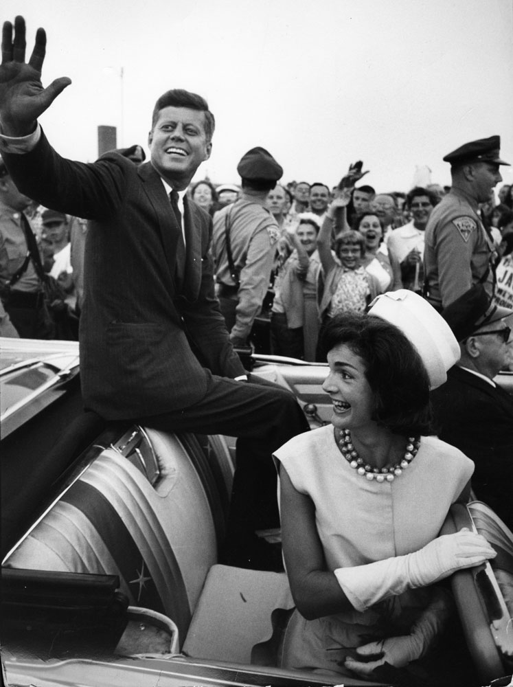 John F. Kennedy rides in a car with his wife Jackie upon his return home from Democratic National Convention in 1960.