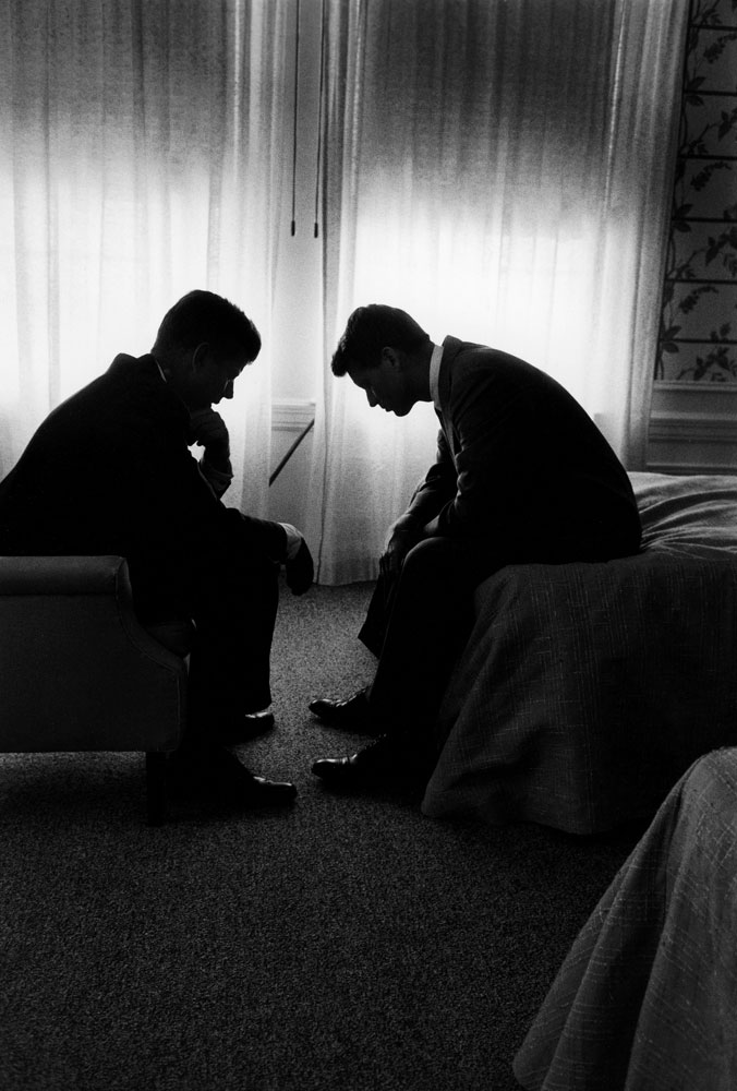 John and Robert Kennedy confer in a Los Angeles hotel suite during the 1960 Democratic National Convention.