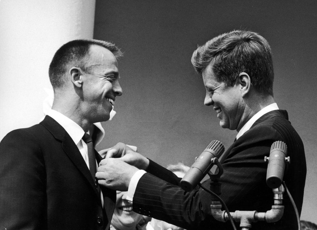 President John Kennedy pins NASA's Distinguished Service Medal on Alan Shepard's chest, 1961.