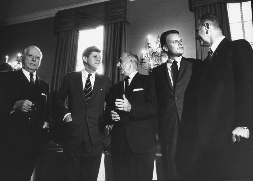 Boyd Leedom (a member of the National Labor Relations Board), President John F. Kennedy, Senator Frank W. Carlson, the Rev. Billy Graham and Vice President Lyndon B. Johnson, 1961.