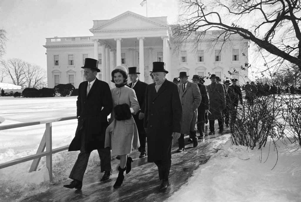 President-elect John F. Kenned, his wife Jackie and others walking to JFK's inauguration, January 1961.