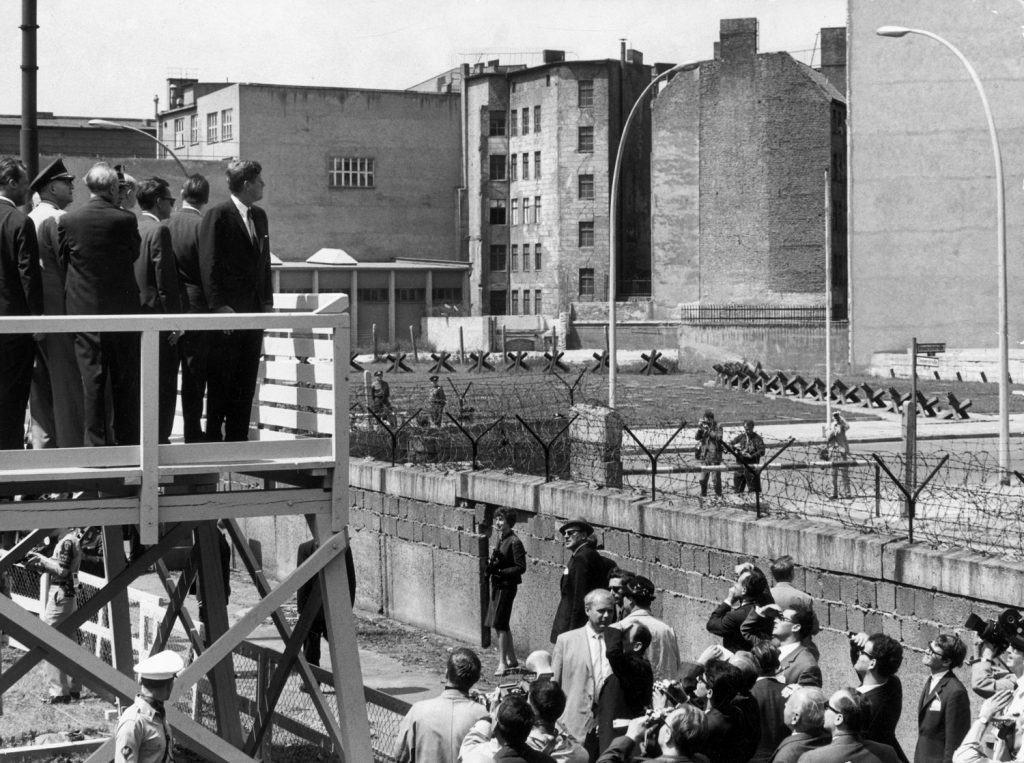 During a visit to West Germany President John F. Kennedy looked over a section of the Berlin Wall, June 1963.