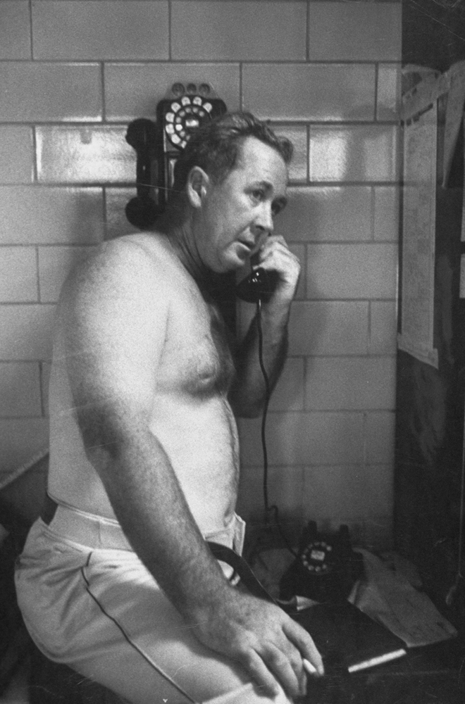 Cincinnati Reds manager Birdie Tebbetts, the Baseball Writers Association Manager of the Year, talks on the phone in the locker room during a Labor Day doubleheader against the Milwaukee Braves in 1956.