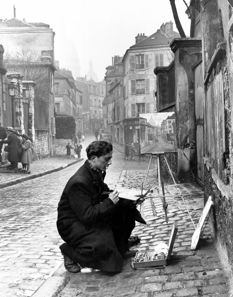 A young artist paints Sacre-Coeur from the ancient Rue Norvins in Montmartre, Paris, 1946.