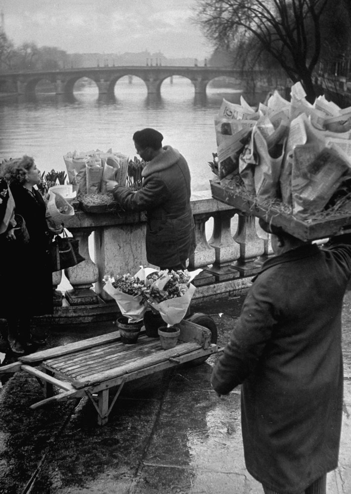 Parisian flower vendor on the banks of the Seine, 1946.
