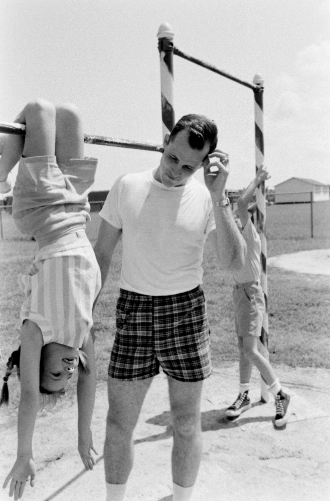 During a family work-out on the horizontal bar, Bonnie Lynn and Eddie White compete against their father, astronaut Ed White.