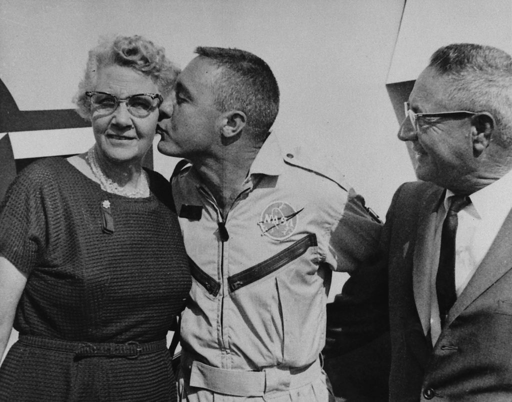 Home a hero after his successful 1965 mission in Gemini 3, [Gus Grissom] greeted his parents who came from Mitchell, Ind. for the flight.