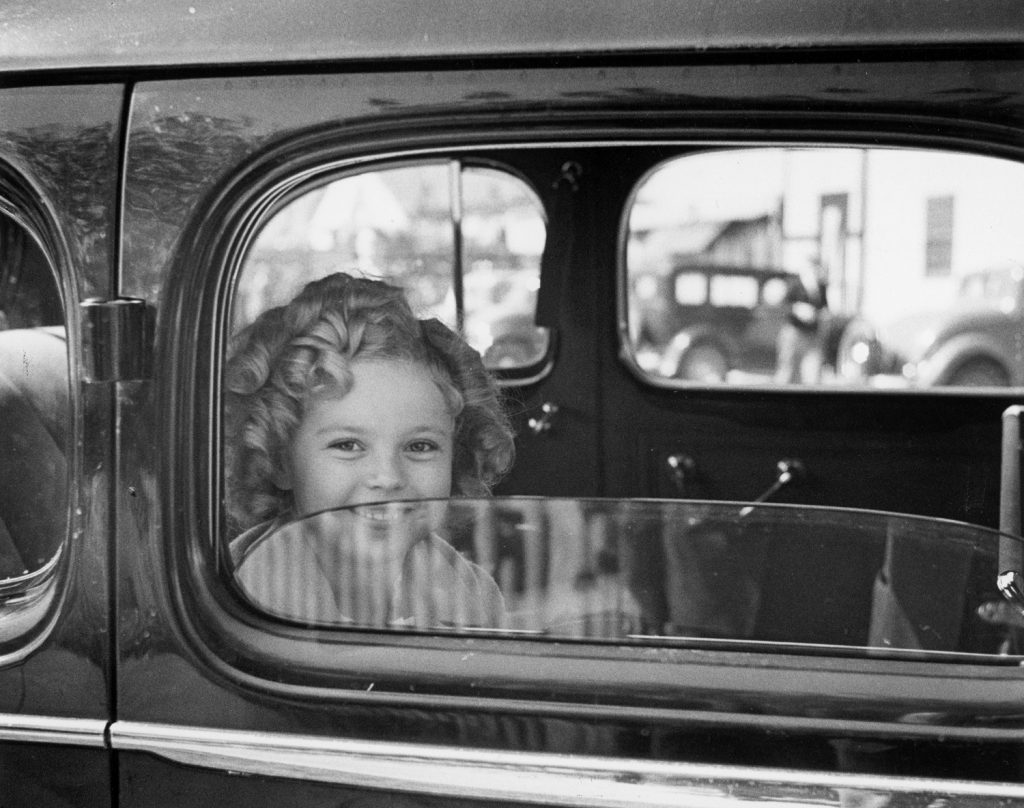 Shirley Temple arrives at the 20th Century Fox studio to celebrate her eighth birthday, 1936.