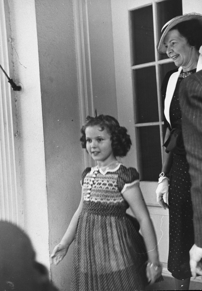 Shirley Temple leaving the White House, 1938.