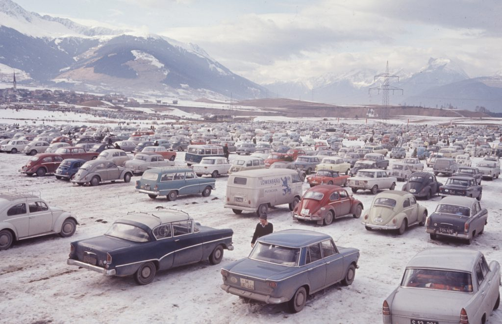 Cars parked at the 1964 Innsbruck Winter Olympics.