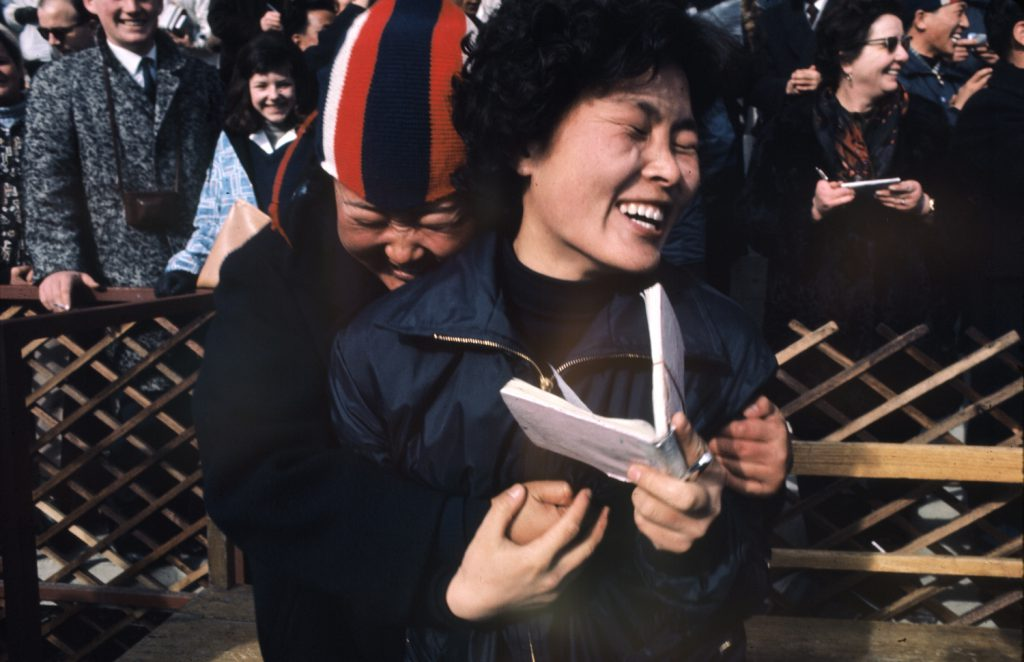 Happy fans and autograph-seekers at the 1964 Innsbruck Winter Olympics.