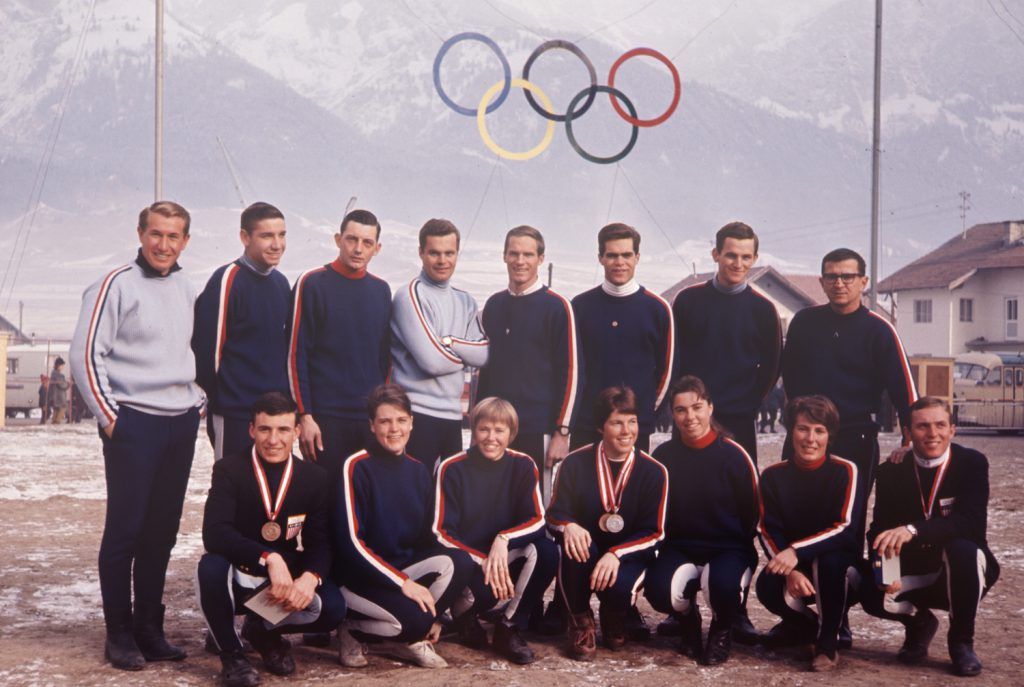 American skiers at the 1964 Innsbruck Winter Olympics, including medalists Jean Suabert (front row, center), James Heuga (front, far left) and Bill Kidd (front, far right).