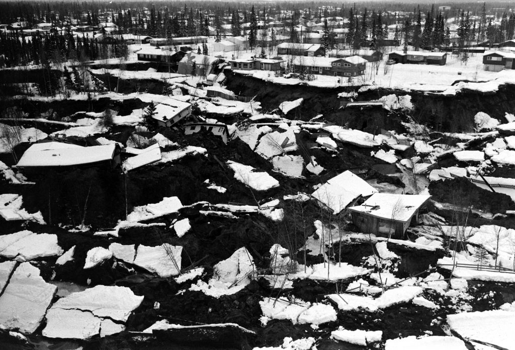 The earthquake split the Turnagain section of Anchorage with a criss-cross of deep fissures in the ground, heaving the smashed homes up at crazy angles.