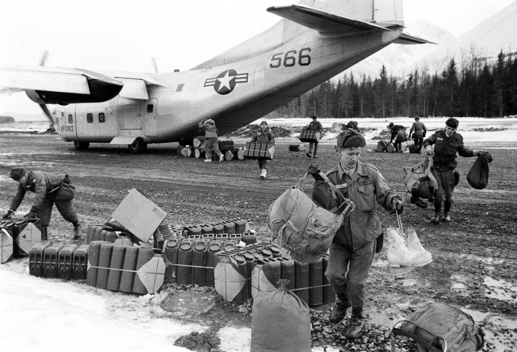 Unloading relief supplies after the March 1964 Good Friday Earthquake, Alaska.