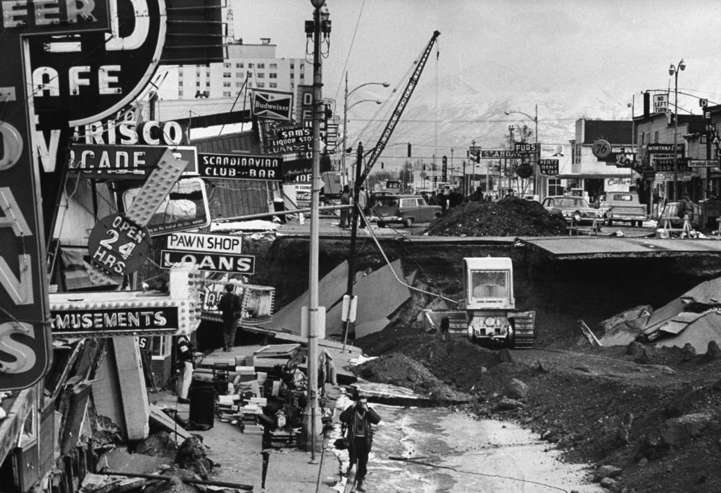 In downtown Anchorage, the buildings and the pavement dropped 20 feet, dividing Fourth Avenue into two levels and leaving a weird jumble of signs.