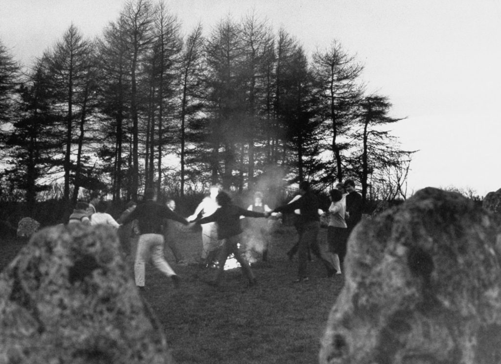 In a thousand-year-old rite, the witches dance around bonfire within prehistoric Rollright stone circle that stands in Oxfordshire.