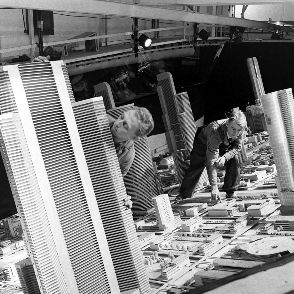 "Craftsmen work on a huge architectural model of ""the city of the future"" at the 1939 World's Fair."