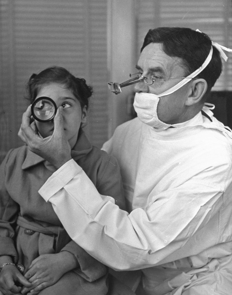 Marie's eyes are examined by Dr. William Hill of Toronto. Her left eye showed improvement, her weaker eye none. She will need glasses