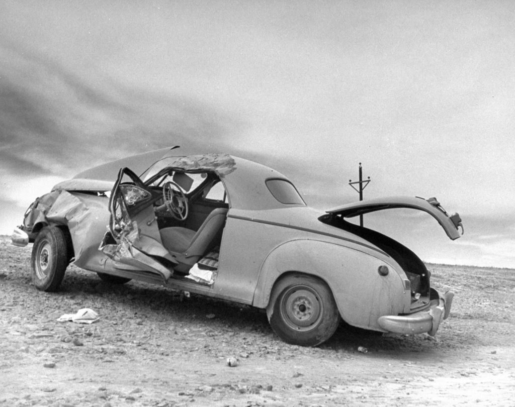 Scene after driver fell asleep at the wheel on Route 30, Nebraska, 1948.