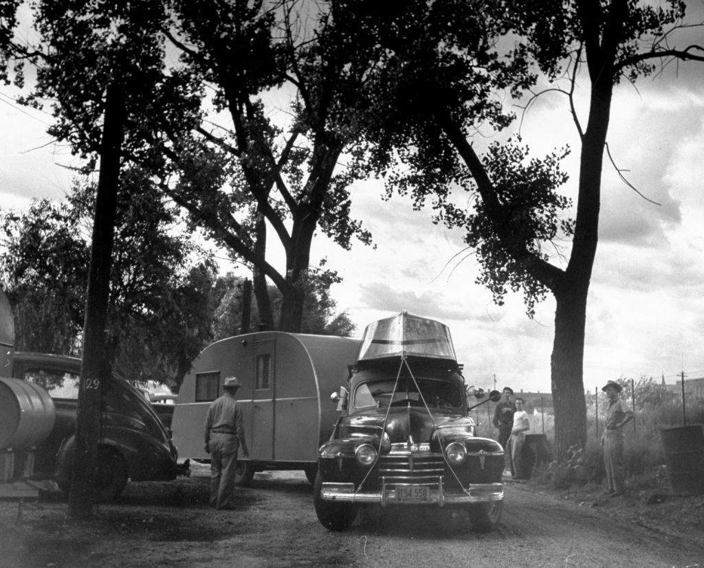 Cars pulling out of trailer camp onto Route 30, Nebraska, 1948.