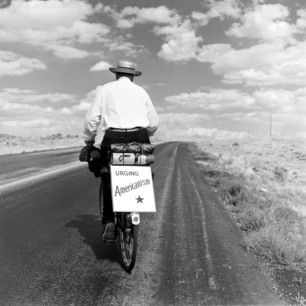 "Charles Corwin White, bicycling from Los Angeles to New York and speaking along the way on ""Americanism"" and citizen participation in a democracy. Here he's photographed west of Rawlins, Wyo., in 1948."
