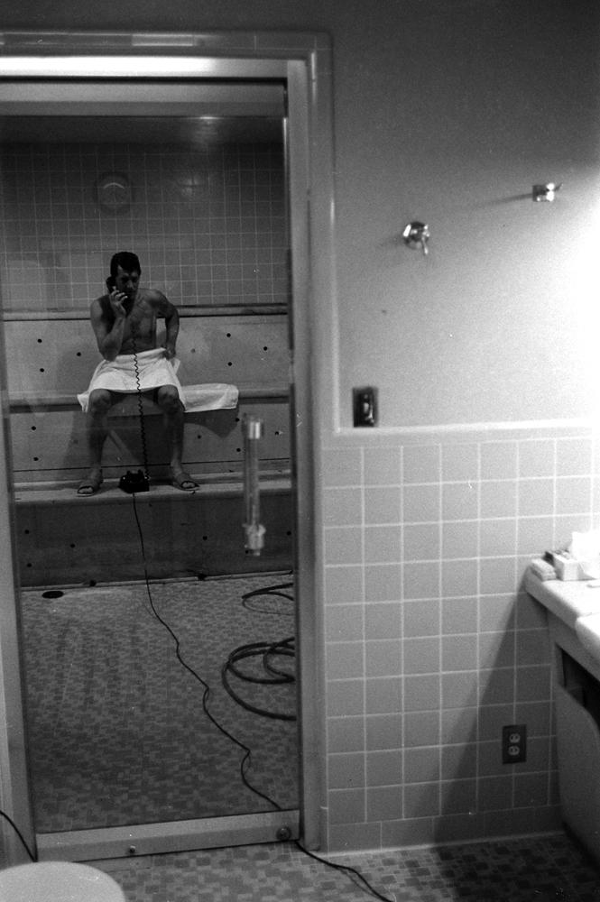 Dean Martin in the steam room, 1958.