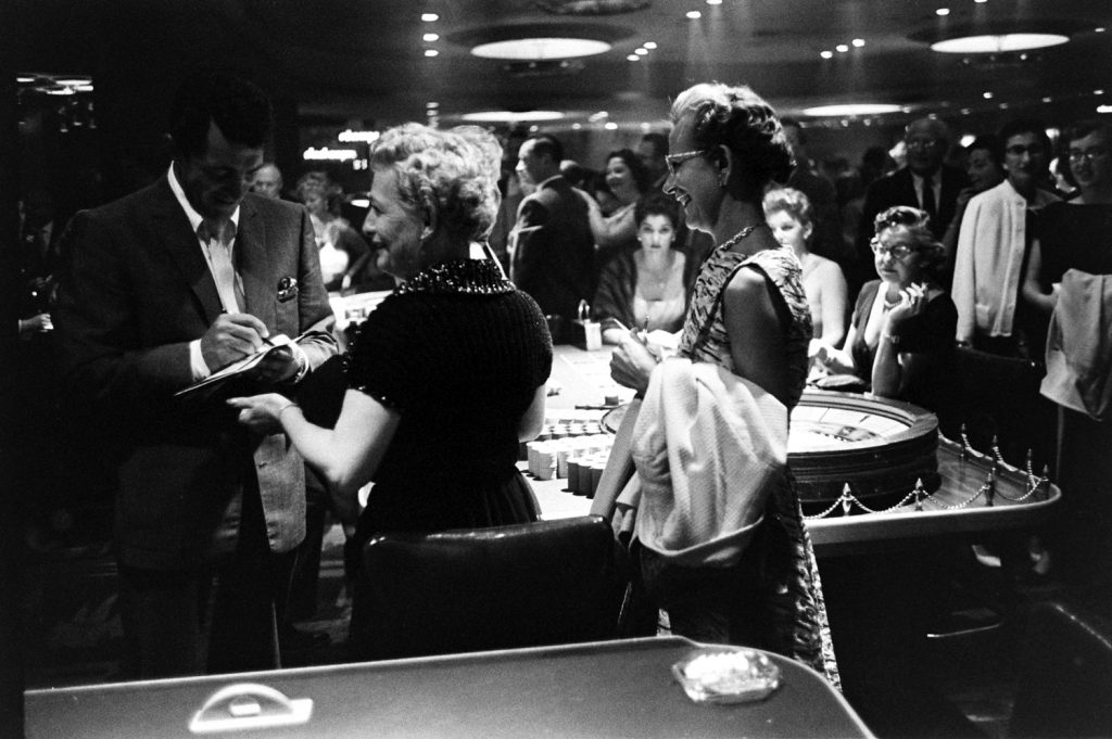 Dean Martin signing autographs, Las Vegas, 1958.