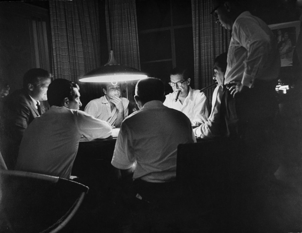 Poker pals in a table stakes game at Martin's home include (clockwise from Dean at left) agent Jerry Gershwin, Tony Curtis, Milton Berle, Ernie Kovacs with 85-cent cigar, director Billy Wilder.