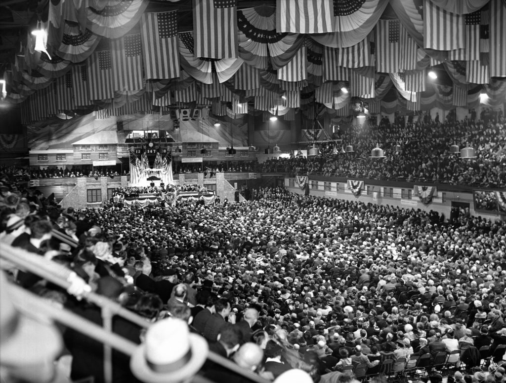 "Crowd of 10,000 at an ""America First Committee"" rally listening to speeches promulgating isolationism and urging the cutting off of aid to Britain, Chicago Arena, 1941"