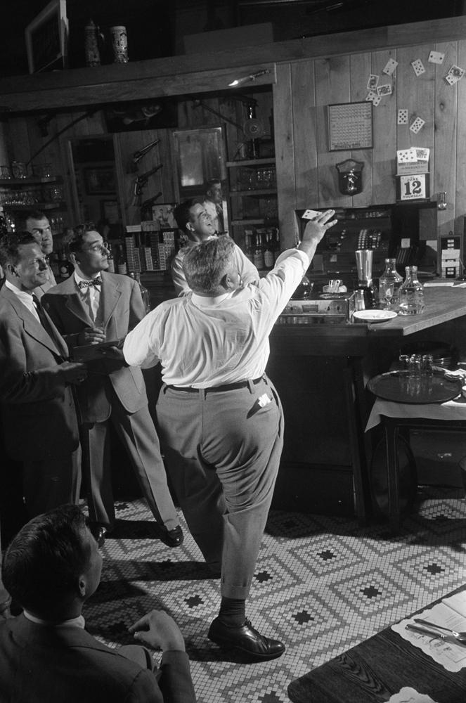 Legendary Chicago club owner Matt Schulien entertains patrons, 1952.