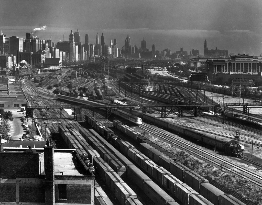 Aerial view overlooking network of tracks for some 20 major railroads converging on Union Station (upper left), Chicago, 1954.