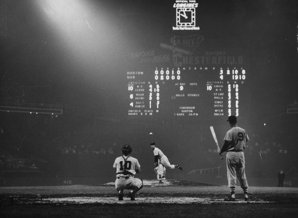Ted Williams waits while pitcher warms up at Comiskey Park, 1957.