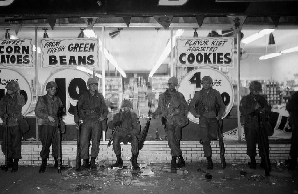 National Guardsmen in front of a store during riots following the murder of Martin Luther King Jr., Chicago, April 1968.