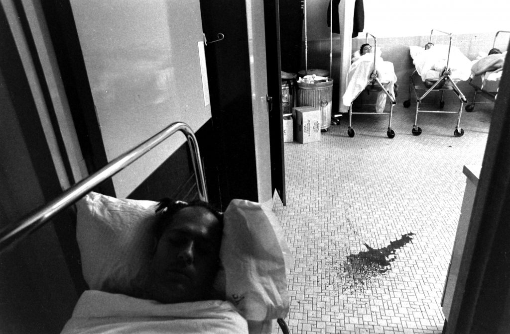 In an enema room of the Bronx VA Hospital in New York, disabled spinal injury patients wait up to four hours to be attended by a single aide, 1970.