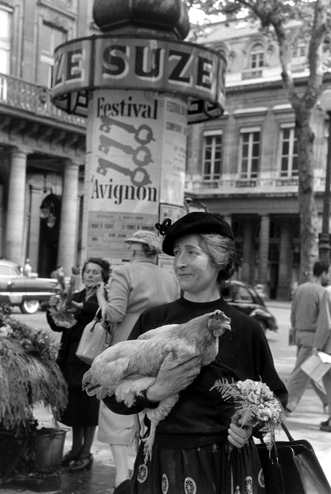 A woman named Marguerite with her chicken, Paris, 1956.