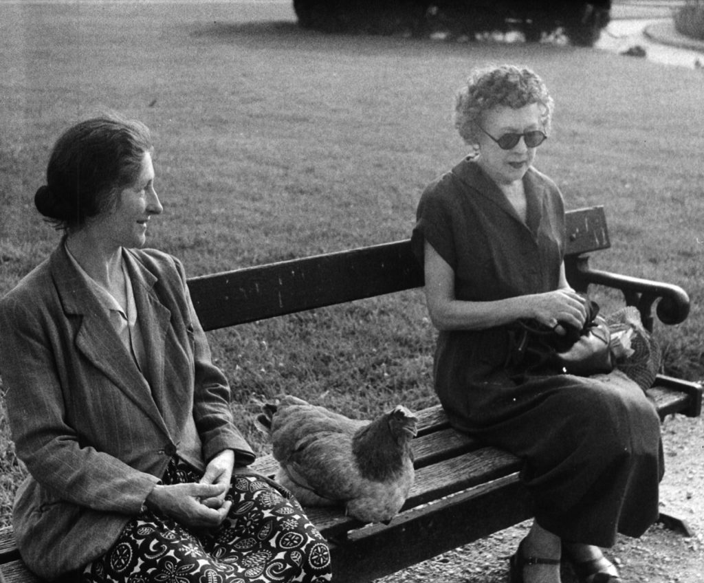 Marguerite (left) and her chicken share a park bench with a woman who appears rather tense, Paris, 1956.