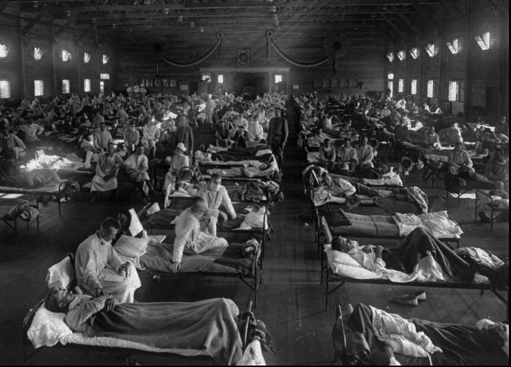 Influenza victims crowd into an emergency hospital near Fort Riley, Kans., in this 1918 file photo.