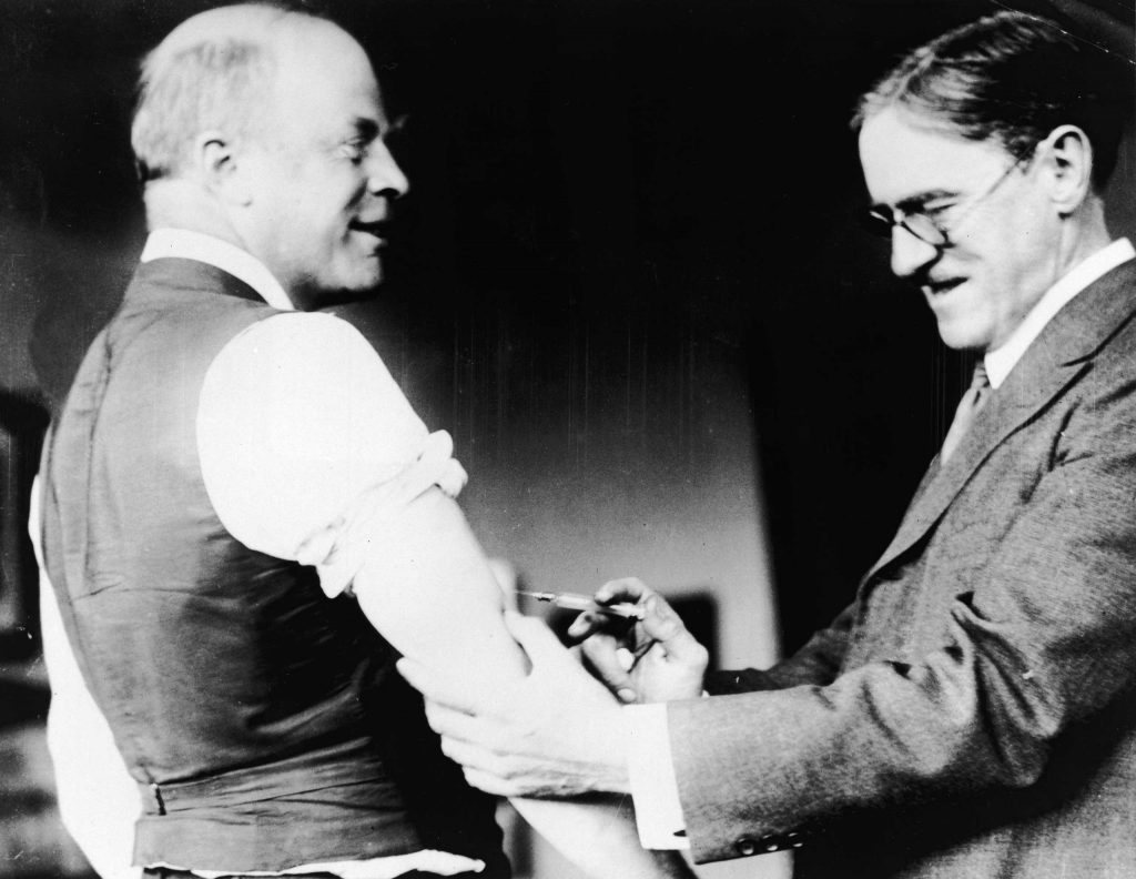 A doctor inoculates Major Peters of Boston against the Influenza virus during the pandemic, 1918.