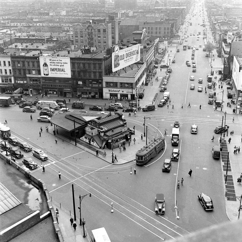 """From photographer's notes: """"Trolleys & tracks at corner of Flushing Ave., Graham & Broadway."""""""