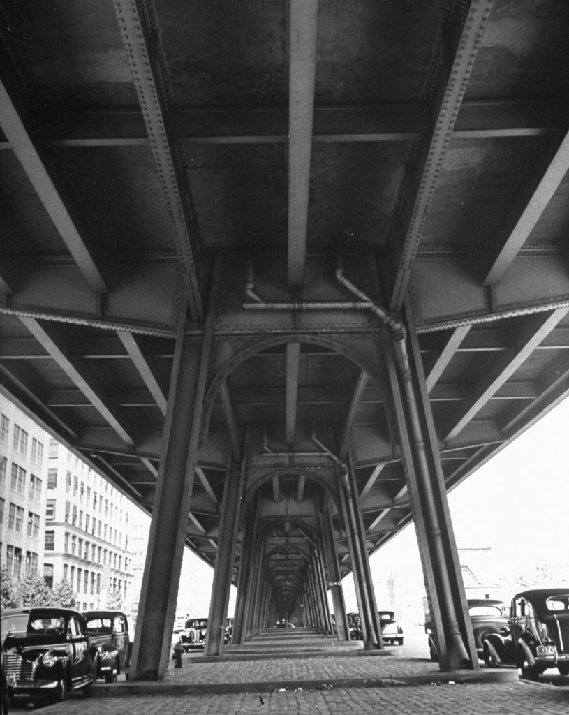 Under the elevated tracks, Broadway at Lynch, Brooklyn, 1946.