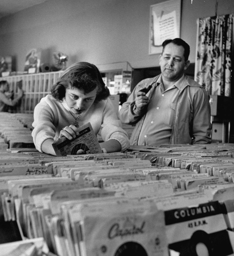 Pay in trade is taken by Margaret High, 17, who works in music store, spends salary on records.