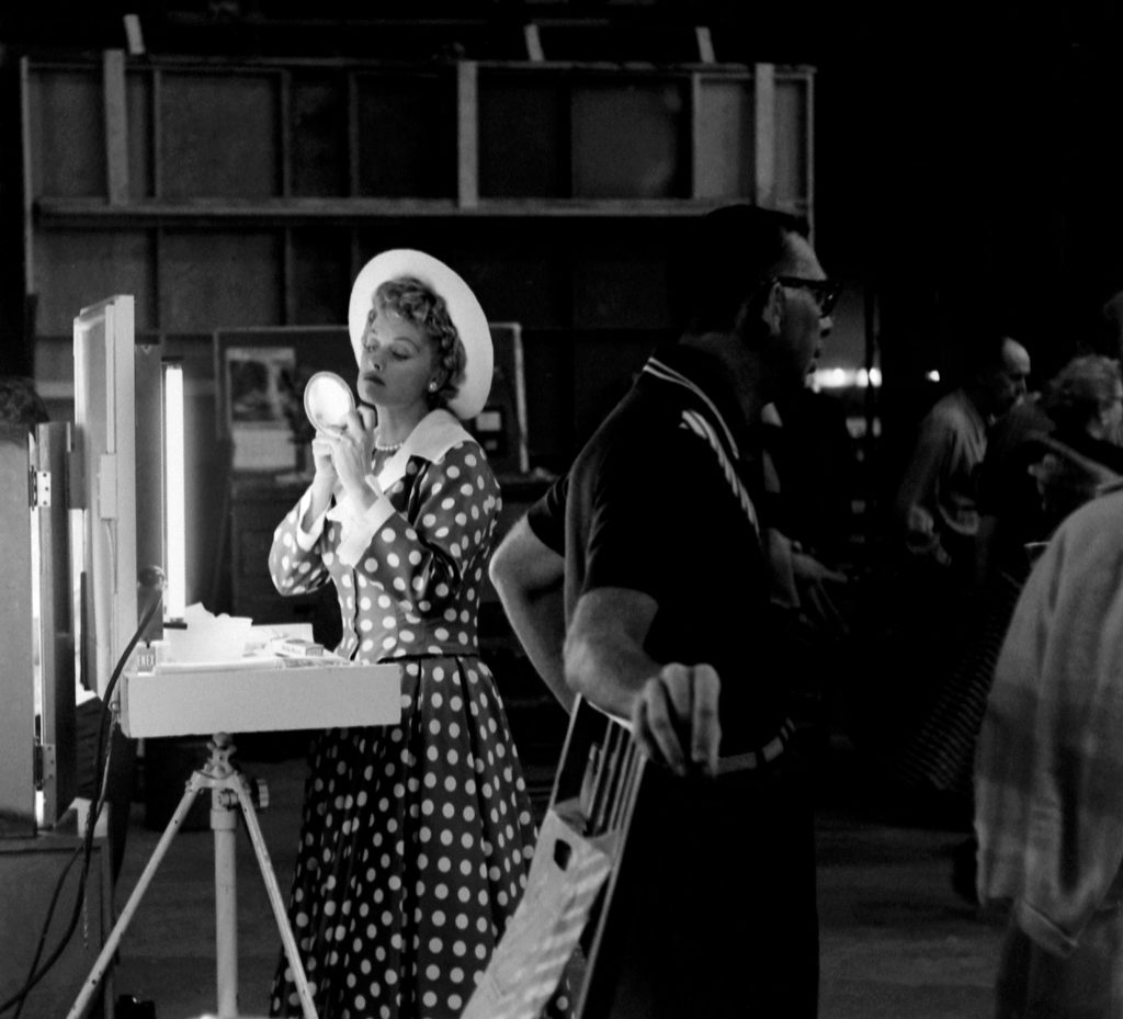 Lucille Ball is a calm eye at the center of a storm of activity at her new Desllu Studios, 1958.