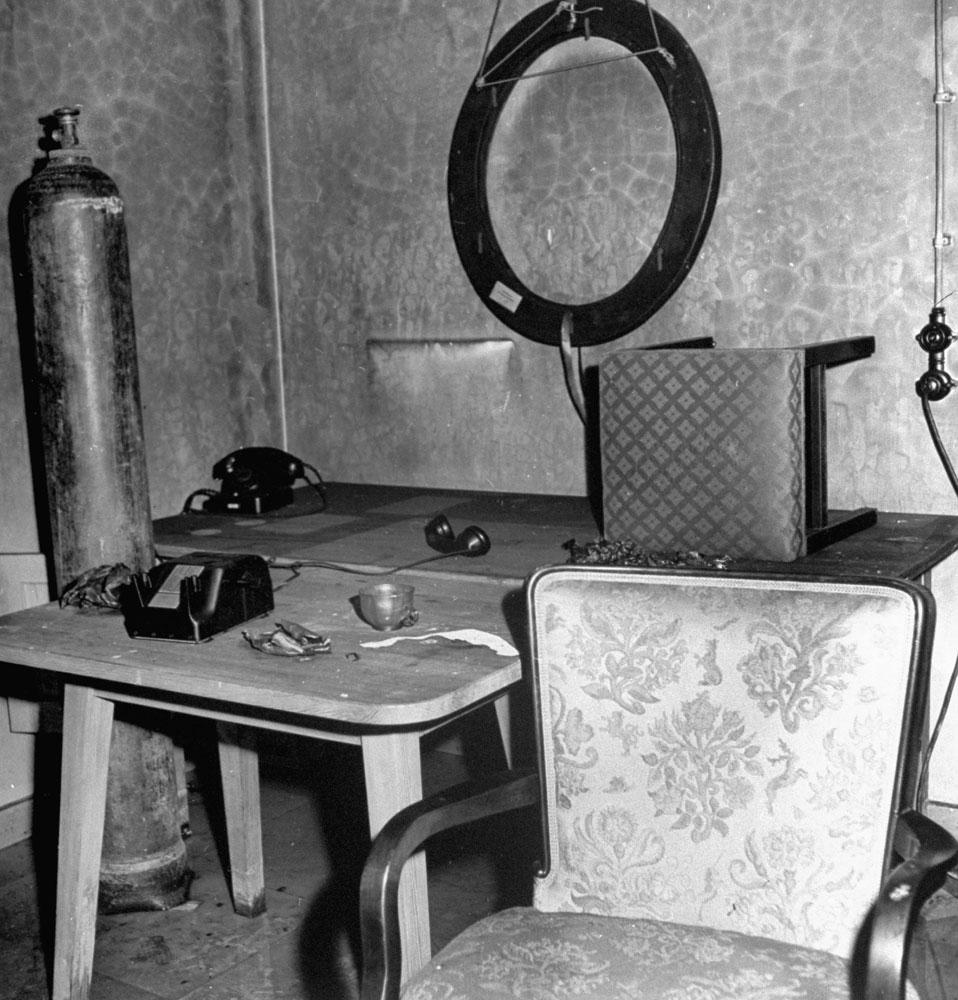 Abandoned furniture and debris inside Adolf Hitler's bunker, Berlin, 1945.