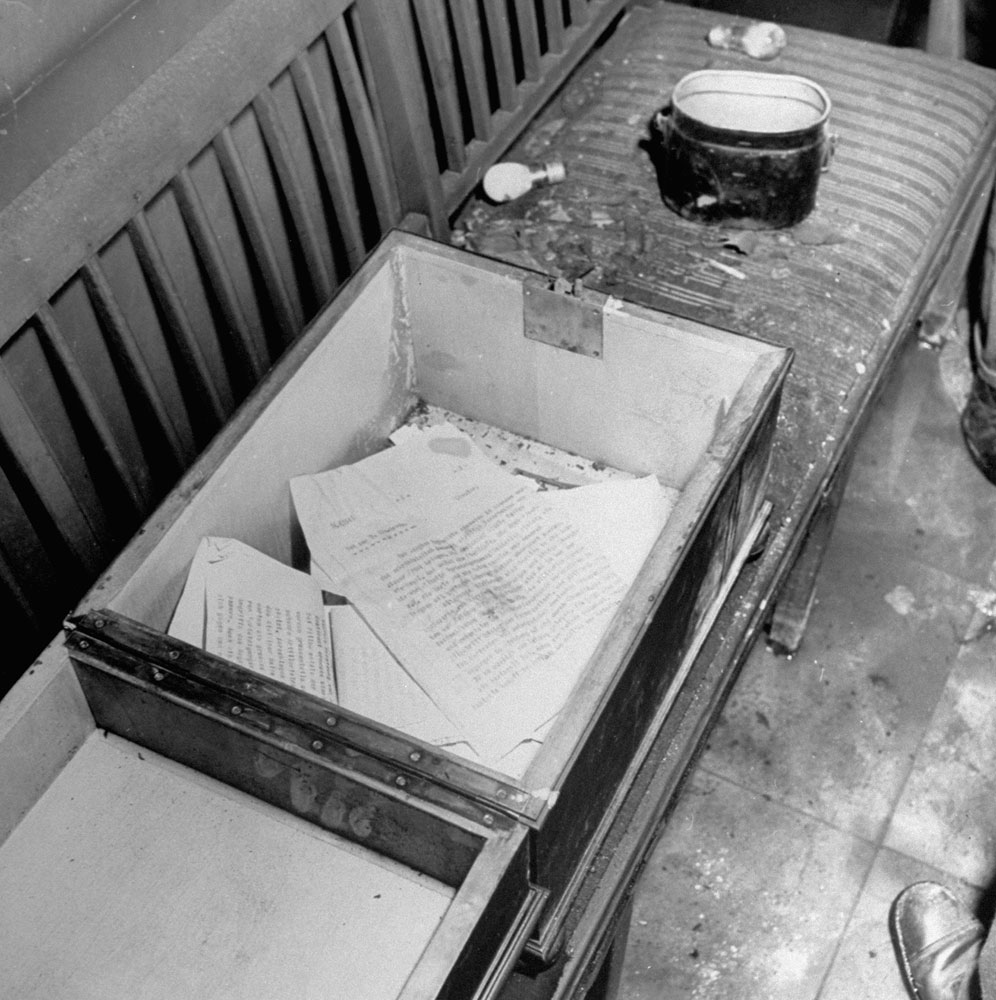 Papers (mostly news reports dated April 29, the day before Hitler and Eva Bruan killed themselves) inside Hitler's bunker, Berlin, 1945.