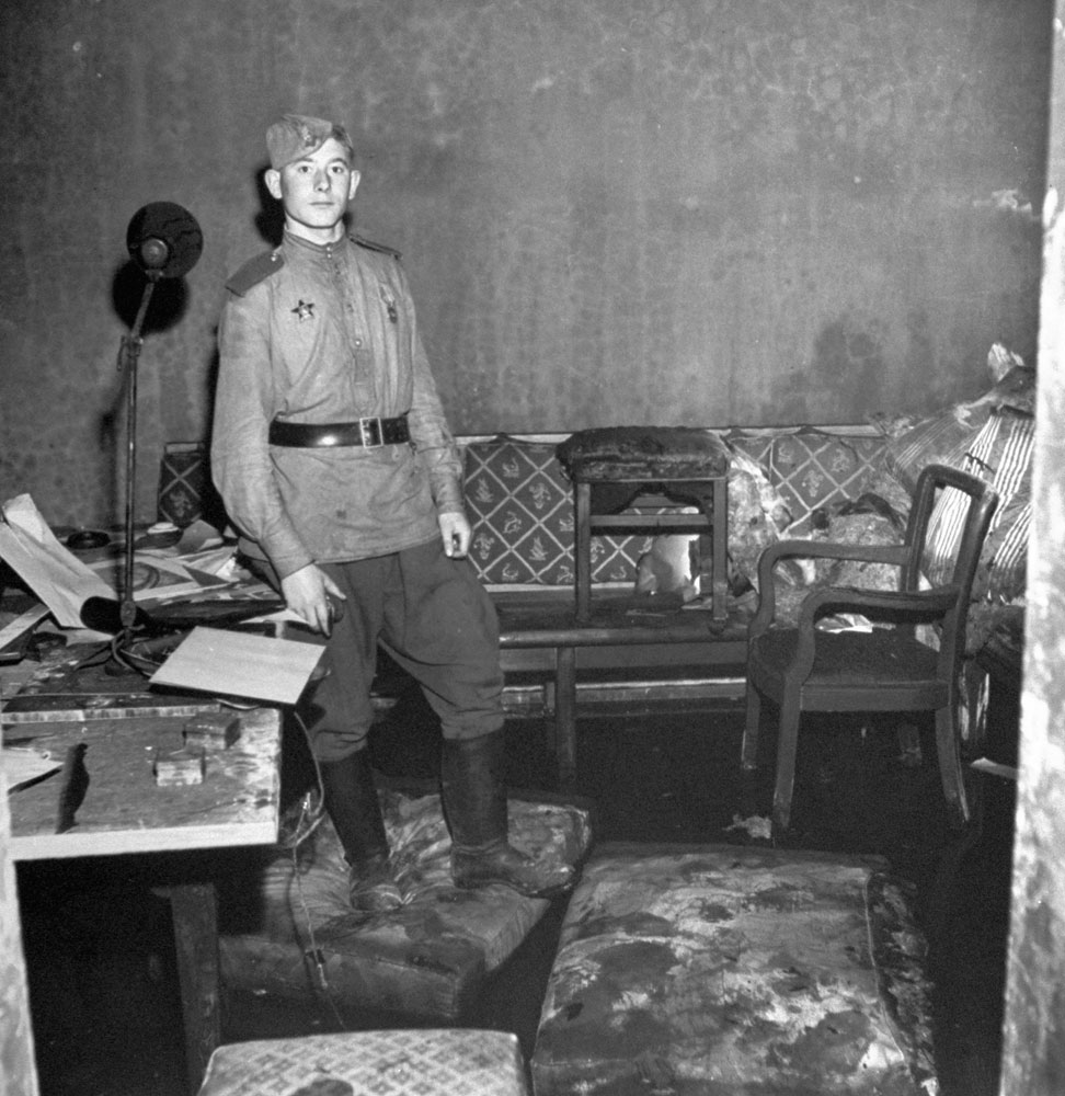 A Russian soldier stands in Adolf Hitler's bunker, Berlin, 1945.