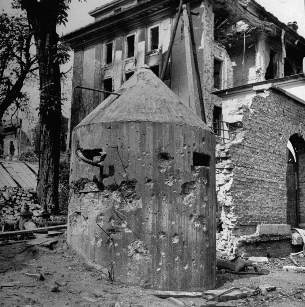 Bullet-riddled sentry pillbox outside Hitler's bunker, Berlin, 1945.
