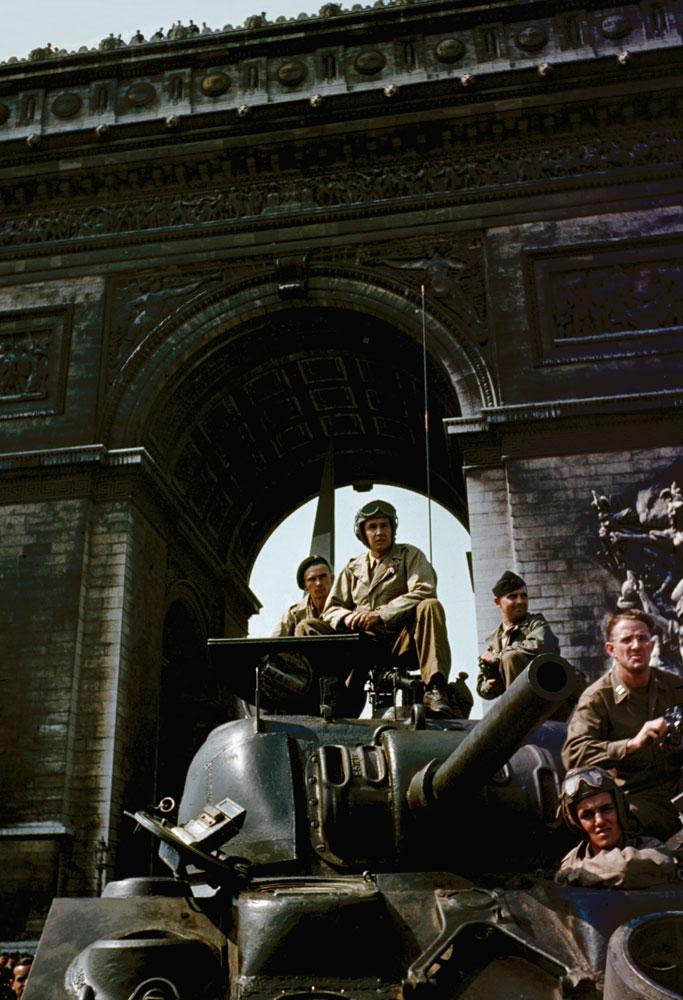 Tanks under the Arc de Triomphe in Paris during liberation celebrations, August 1944.