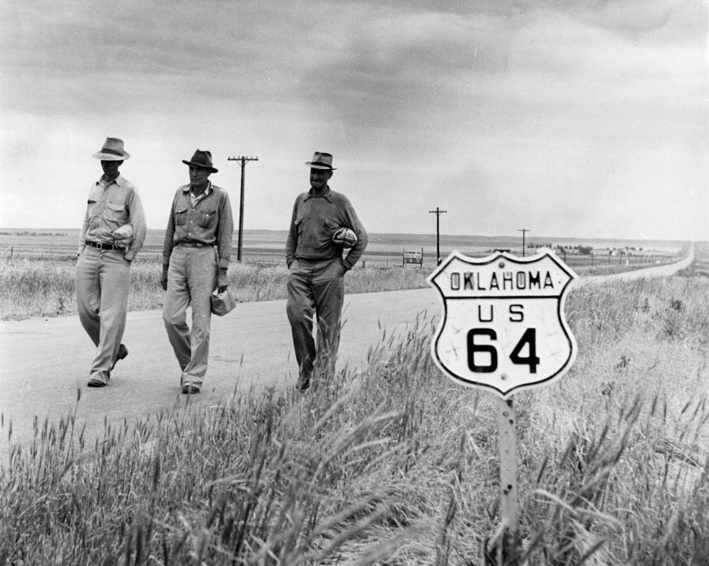Harvesters hitchhike to a wheat harvesting, Oklahoma, 1942.