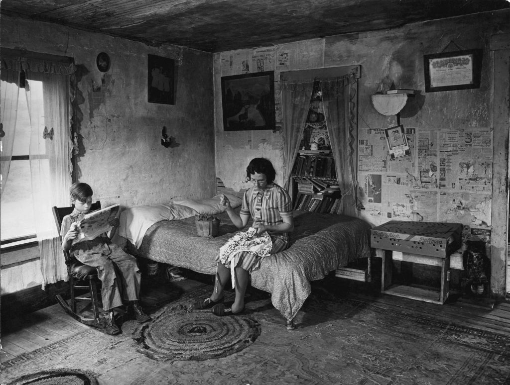 Mrs. Venus Barnett and son Lincoln in room of their farmhouse, Oklahoma, 1942.